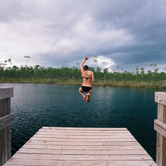 woman jump into lake